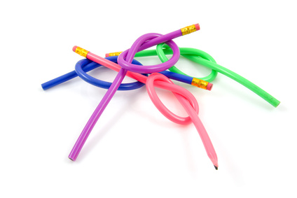 Knotted colorful pencils over white background